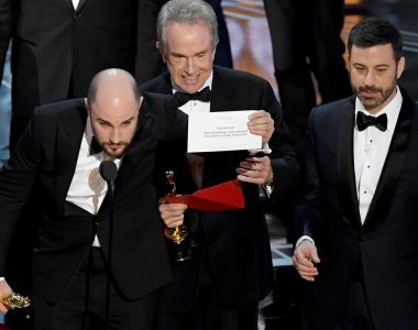 Mix-up: La La Land producer Jordan Horowitz holds up the correct best picture winner card, reading  Moonlight, as actor Warren Beatty and host Jimmy Kimmel look on. Photograph:  Kevin Winter/Getty