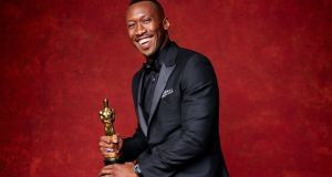 Best supporting actor: Mahershala Ali with his Oscar for Moonlight. Photograph: Jeff Lipsky/EPA