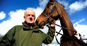 Trainer Willie Mullins  with Douvan at his stables at Closutton, Co Carlow. Photograph: PA Wire