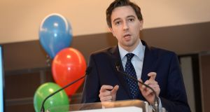 Minister for Health Simon Harris: with Finian McGrath, he  will ask for an early signature from the President, Michael D Higgins, to ensure up to 330,000 people can avail of lower costs.  Photograph: Dara Mac Dónaill