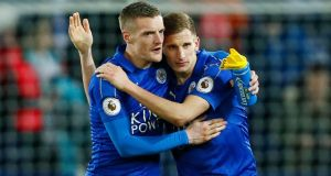 Jamie Vardy and Marc Albrighton celebrate after Leicester City's win over Liverpool. Photograph: Jason Cairnduff/Reuters