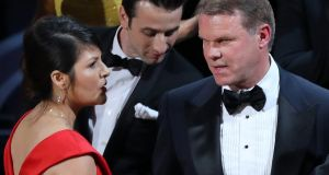 "Brian Cullinan (R) and Martha Ruiz (L) of PricewaterhouseCoopers confer on stage after the Best Picture was mistakenly awarded to ""La La Land"" instead of ""Moonlight"". Cullinan gave presenters Warren Beatty and Faye Dunaway the wrong envelope for the Best Picture Award, accounting firm PricewaterhouseCoopers said in a statement. REUTERS/Lucy Nicholson TPX IMAGES OF THE DAY"