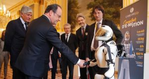 French president François Hollande shakes hands with Cybedroid robot Leenby at the Élysée Palace in Paris during the Viva Technology conference. Photograph: Michel Euler/AFP/Getty Images