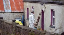 Garda forensics searching for evidence at the home of Paddy Lyons at Ballysaggart, near Lismore. Photograph: Michael Mac Sweeeney/Provision