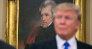 Donald Trump: the 45th US president has hung Andrew Jackson's portrait in the Oval Office. Photograph: Al Drago/New York Times