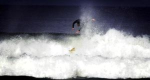 A surfer  in Strandhill Co Sligo  – one of three non-Blue Flag beaches  on the TripAdvisor list. Photograph: Bryan O'Brien