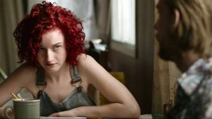 Julia Garner and Jake Weary in 'Tomato Red'