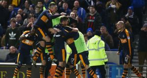 Ayoze Perez is mobbed by his Newcastle team-mates after scoring the winning goal in the Championship match against Brighton  at the Amex Stadium. Photograph: Jordan Mansfield/Getty Images