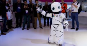 A robot dances on a Chinese mobile company's stand during the Mobile World Congress in Barcelona. Photograph: Josep Lago/AFP/Getty Images