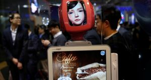 Commerce Bot, a robot that provides customer service with artificial intelligence technology and voice recognition, at SK telecom's stand. Photograph: Reuters/Paul Hanna