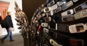 Old mobile phones are made into artwork  at the Aptoide stand. Photograph:  Reuters/Paul Hanna
