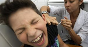 A child is vaccinated against yellow fever in a hospital in Brasilia, Brazil. So far this year, Brazil has had 234 confirmed cases of yellow fever and 79 deaths from the mosquito-borne disease. Photograph: Joedson Alves/EPA