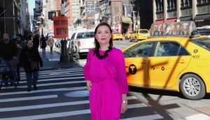 Margaret Molloy #WearingIrish on the streets of New York. Dress by Courtney Lennon for Dunnes Stores. Necklace by Melissa Curry Design.