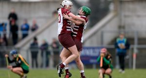 Slaughtneil's Josie McMullan and Siobhán McKaigue celebrate at the final whistle after the semi-final win over Tipperary and Munster champions, Burgess Duharra. Photograph: Donall Farmer/Inpho