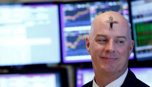 A  trader with ash  on his forehead for Ash Wednesday  works on the floor of the New York Stock Exchange where banks and industrial stocks were the biggest gainers. Photograph: Brendan McDermid/Reuters