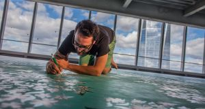 David Uda painting his memorial floorpiece 'Bloom' on the 69th floor of 4 WTC. Photograph: Allen Kiely