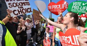 "Anti-abortion demonstrators  at the 2013   ""Rally for Life"" in  Dublin's O'Connell Street. Photograph: Alan Betson"