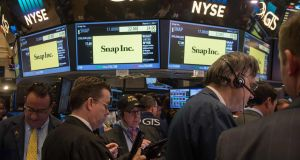 Traders work on the floor during the Snap Inc IPO at the New York Stock Exchange. Photograph: Getty Images