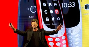 Arto Nummela, chief executive officer at HMD Global, with the re-launched Nokia 3310 phone. It is an upgrade on the original with a larger colour screen, micro-USB charging and a camera. Photograph: Emilio Morenatti/AP Photo
