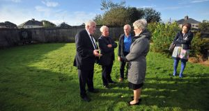 Tom Warde, Loughrea, Walter Francis, Athenry and P.J. Haverty speak to Minister Katherine Zappone at the site of the Tuam Mothers and Baby home. Photo: Ray Ryan