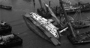 Raising the  capsized Herald of Free Enterprise with a winch in 1987, at Zeebrugge in Belgium.  Photograph: PA