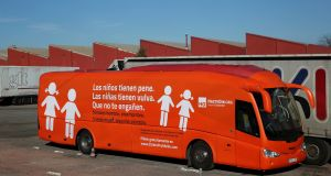 "A bus with the anti-transgender message: ""Boys have penises, girls have vulvas, don't be fooled"" in a carpark in Coslada, outside Madrid. Photograph: Susana Vera/Reuters"