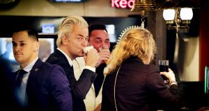 Dutch far-right leader Geert Wilders drinks a beer  in a cafe in Volendam on Friday, after he resumed electioneering following a scare over his security. Photograph: Remko de Waal/EPA