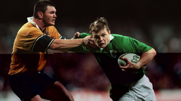 Brian O'Driscoll holds off Daniel Herbert of Australia on his Irish debut in 1999. Photograph: Patrick Bolger/Inpho