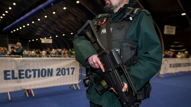 A PSNI officer patrols at the Belfast count centre on Friday night. Photograph: Liam McBurney/PA