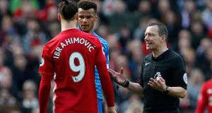 Manchester United's Zlatan Ibrahimovic and Bournemouth's Tyrone Mings are spoken to by referee Kevin Friend. Photo: Andrew Yates/Reuters