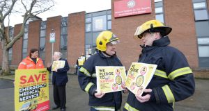 SIPTU members Dublin Fire Brigade with members of the public and elected representatives protest against the break up of the DFB Emergency Medical Service, at North Strand Fire Brigade Station. Dublin. Photograph: Dara Mac Dónaill / The Irish Times