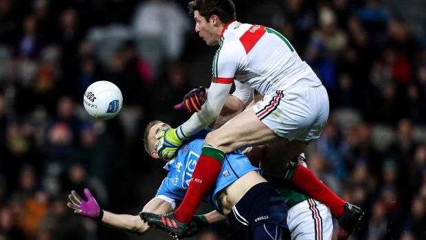 Dublin's Eoghan O'Gara collides with David Clarke and Lee Keegan of Mayo. Photo: Tommy Dickson/Inpho