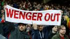 Arsenal fans protest with a banner against manager Arsene Wenger during their Premier League clash with Liverpool. Photo: Lee Smith/Reuters