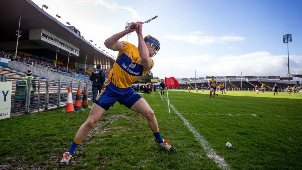 Seadna Morey of Clare takes a sideline cut. Photo: Cathal Noonan/Inpho