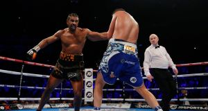 David Haye drags his injured right leg behind him on his way to losing to Tony Bellew at the O2 in London on Saturday night. Photograph: Andrew Coulridge/Reuters.