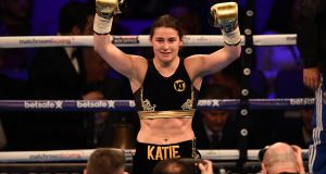 Katie Taylor celebrates beating Italian boxer Monica Gentili.The Irish boxer was quietly satisfied with her evening's work. Photograph: Justin Tallis/AFP