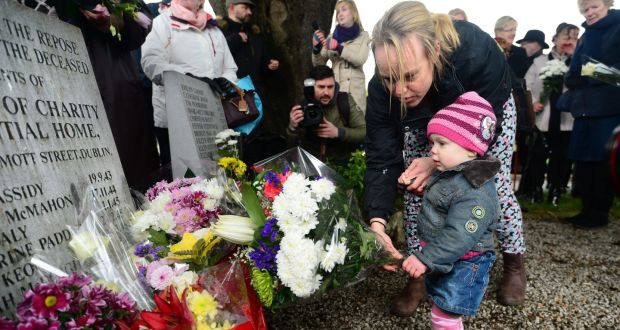Joanne Byrne, from Finglas, with her daughter Róise (18 months) at the sixth annual 'Flowers for Magdalenes' remembrance event at Glasnevin Cemetery in Dublin. Photograph: Dara Mac Dónaill