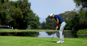 Dustin Johnson of the United States putts on the sixth hole during the final round of the World Golf Championships Mexico Championship at Club De Golf Chapultepec in Mexico City, Mexico. Photo: Buda Mendes/Getty Images