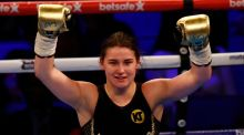Katie Taylor celebrates her fifth round victory over Monica Gentili at the O2 Arena in London. Photograph: Peter Cziborra/Livepic