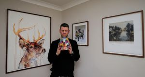 Shaun Davin with his Spin painted skull and in the background  Dave White's Stag, silk screened with diamond dust; Joram Roukes piece called Action on Spring and Charming Baker's lost. Photograph: Nick Bradshaw