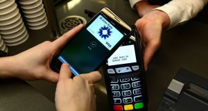 The Apple Pay service is protected with your device's pass code or Touch ID fingerprint reader. Photograph: Dara Mac Dónaill