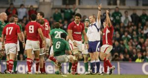 Referee Wayne Barnes awards a penalty to Wales in the last minute of normal time which leads to Ireland's defeat in the 2012 Six Nations match at the Aviva Stadium. Photograph: Alan Betson.