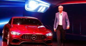 Dieter Zetsche of  Mercedes brings on stage the new AMG GT Concept that will enter production