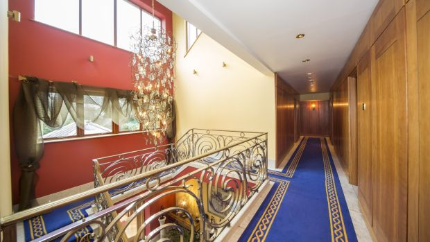 The upstairs landing resembles a ship's corridor flush with hand-tufted carpet and cherrywood panelled walls.