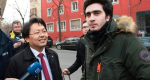 File image of Syrian refugee Anas Modamani  and his lawyer Chan-jo Jun outside the district court in Wuerzburg, southern Germany. Photograph: Thomas Kienzle/AFP/Getty Images