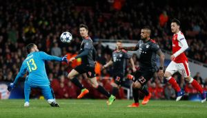 Bayern Munich's Arturo Vidal scores their fourth goal in a 5-1 Champions League last 16 second leg win at the Emirates Stadium. Photo: John Sibley/Reuters
