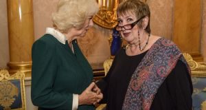 Jenni Murray, the presenter of BBC Radio 4's Woman's Hour chats with  Camilla, Duchess of Cornwall chats at  a reception and recording at Buckingham Palace to mark the announcement of the Woman's Hour 70th Anniversary Power List on December 13, 2016 in London, England. (Photo by Arthur Edwards - WPA Pool / Getty Images)