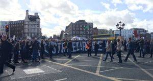 Protesters on O'Connell Bridge in Dublin as part of an event calling for the repeal of the Eighth Amendment to mark International Women's Day. Photograph: Elaine Edwards.