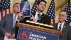 Republican Speaker of the House Paul Ryan  holds up a copy of the American Health Care Act during a news conference unveiling the plan to repeal and replace Obamacare. Photograph: Chip Somodevilla/Getty Images
