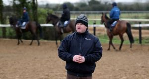Trainer Gordon Elliott at his  stables in Longwood, Co Meath: he  is an odds-on favourite to dethrone Willie Mullins as Ireland's champion trainer later this season. Photograph: PA Photo